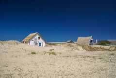 Houses in sand dunes Stock Photo