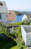 Houses by the sea. Old, traditional, wooden houses in Loshavn near Farsund, Vest-Agder on the south coast of Norway Stock Image
