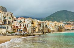 Houses by the sea in Cefalu stock photography