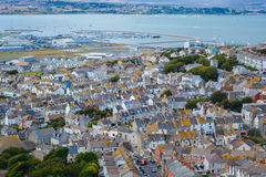 Houses by the Sea. Houses near the Famous Chesil beach near portland in Weymouth, Dorset, Southern England royalty free stock images