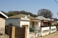 Houses in a neighborhood in Johannesburg. Houses with security in a residential neighborhood in the less wealthy suburb in Southern Johannesburg, South Africa Royalty Free Stock Images