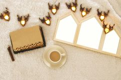 Houses shape wooden photo frames over cozy and warm fur carpet. Top view. For photography montage Stock Photos