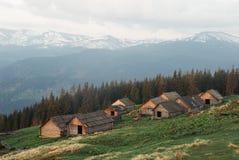 Houses of shepherds in Carpathian. Mountains Royalty Free Stock Photo