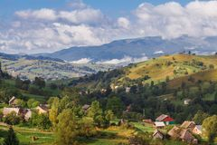 Houses of shepherds in mountains in carpathian. Blue sky cloud Royalty Free Stock Image