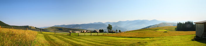 Houses of shepherds in mountains. In carpathian summer Stock Image