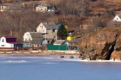 House on the shore of the frozen sea Royalty Free Stock Images