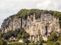 Houses on the side of a mountain. In Aquitaine, France on a cloudy day stock images