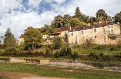 Houses on the side of a mountain. In Aquitaine, France on a cloudy day Royalty Free Stock Image