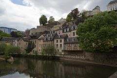 Houses at side of river scene Alzette in Luxembourg from Rue Mun. Ster street royalty free stock photos