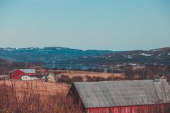 Houses at the side of the road in Varanger Peninsula northern Norway. Some houses and fields at the side of the road in northern Norway Varanger Peninsula royalty free stock photo