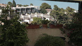 Houses on the slopes of hills, villas and mansions. Spanish beaches in Cala Mendia. Mallorca