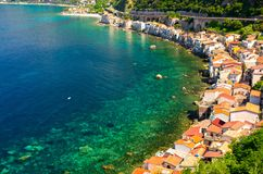Houses in small fishing village Chianalea di Scilla, Calabria, I. Aerial top view of houses in small fishing village Chianalea di Scilla from old medieval castle stock photography
