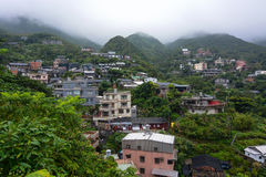Houses in a small hillside village in the misty mountains of Jiufen, Taiwan Stock Photography