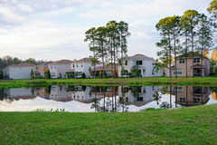 Houses and a small pond form perfect reflection Stock Photos