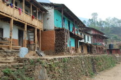 Houses in a small village on a mountain in Nepal. Five homes along a street  in a small mountain village in Nepal Stock Images
