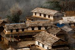 Houses and smoke hearth in a Nepalese village. House in a Nepalese village. Traditional Nepalese house, trekking to the Annapurna. Houses and smoke hearth in a royalty free stock images