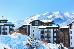 Houses and snow mountains panorama in Bansko, Bulgaria Royalty Free Stock Photo