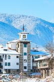 Houses and snow mountains panorama in Bansko, Bulgaria Royalty Free Stock Images