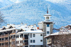Houses and snow mountains panorama in bulgarian ski resort Bansko Stock Photos