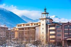 Houses and snow mountains panorama in bulgarian ski resort Bansko Royalty Free Stock Images