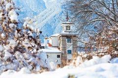 Houses and snow mountains panorama in bulgarian ski resort Bansko Stock Image