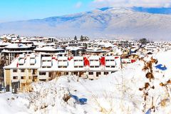 Houses with snow roofs panorama in Bansko, Bulgaria Stock Photos