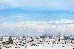 Houses with snow roofs panorama in bulgarian ski resort Bansko Stock Images