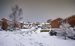 Houses in Snow in United Kingdom. TELFORD, UK - DECEMBER 08, 2017 : Heavy Snowfall view over Residental Estate with Roads and Cars Covered in Snow royalty free stock photos
