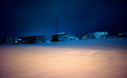 Houses on snowy hill at night Royalty Free Stock Photography