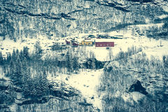 Houses in snowy mountains Royalty Free Stock Photos