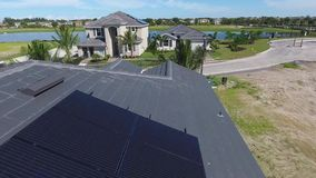 Houses with solar energy panels on roofs, small suburbian eco village, aerial shot in 4k stock footage