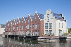 Houses with solar panels on the roof for alternative ener Royalty Free Stock Photography