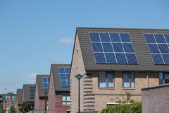 Houses with solar panels on the roof for alternative energy Royalty Free Stock Photo