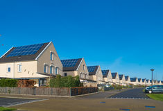 Houses with solar panels Stock Photo