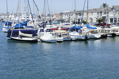 Houses and Speed Boats. These speed boats were docked beside of the houses owners at the New Port Beach in CA Stock Photos