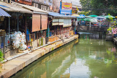 Houses standing above the water channel. Bangkok Royalty Free Stock Photo