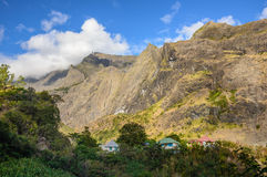 Houses and steep cliffs inside the cirque of Mafate, Reunion Stock Photos