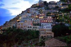 Positano houses evening. Houses on the steep hillside of Positano as daylight fades and lights come on. Italy Stock Images