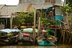 Houses on stilts along the Mekong river in Vietnam, Southeast Asia Stock Photos