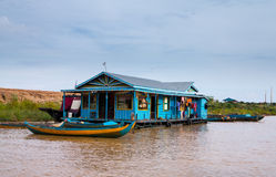 Houses on stilts on Lake Tonle Sap Cambodia. Floating village on Lake Tonle Sap in Cambodia with some houses made from boats Royalty Free Stock Image