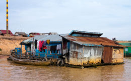 Houses on stilts on Lake Tonle Sap Cambodia. Floating village on Lake Tonle Sap in Cambodia with some houses made from boats royalty free stock photography