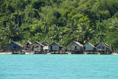 Houses on stilts. The Moken Sea Gypsy Village at Koh Surin Tai in the Mu Ko National Park, Surin Islands of Thailand with its thatched houses on stilts Stock Photos