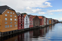 Houses on stilts. Oleson.Norway. View on houses on stilts in Oleson norwegian city. Colourful pictures  with calm smooth surface of the sea water. Oleson Stock Image
