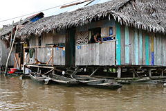 Houses on stilts rise above the polluted water in Belen, Iquitos Royalty Free Stock Photography