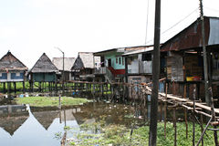 Houses on stilts rise above the polluted water in Belen, Iquitos. Thousands of people live here in extreme poverty without clean water or sanitation stock photos