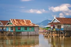 Houses on stilts in Sumbava. Small homes on stilts in a village in the Sumbava Island, Indonesia stock images
