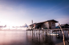 Houses on stilts at sunrise Stock Photography