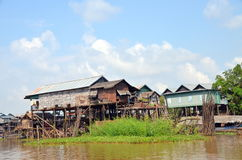 Houses on stilts in which people live in the village on the lake Tone lesap, Siem Reap, Cambodia Stock Images