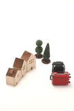 Houses and suitcases on white background. 