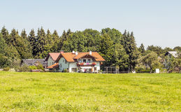 Houses surrounded by meadows Royalty Free Stock Photos